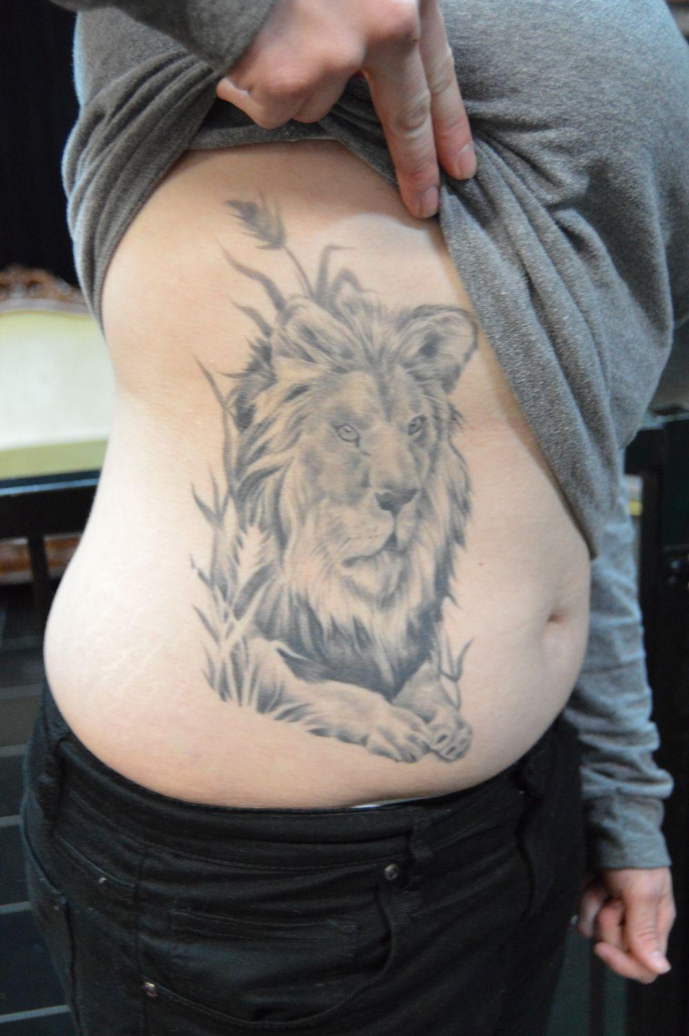 Bg14 true grit tattoo parlor for Tenth street tattoo